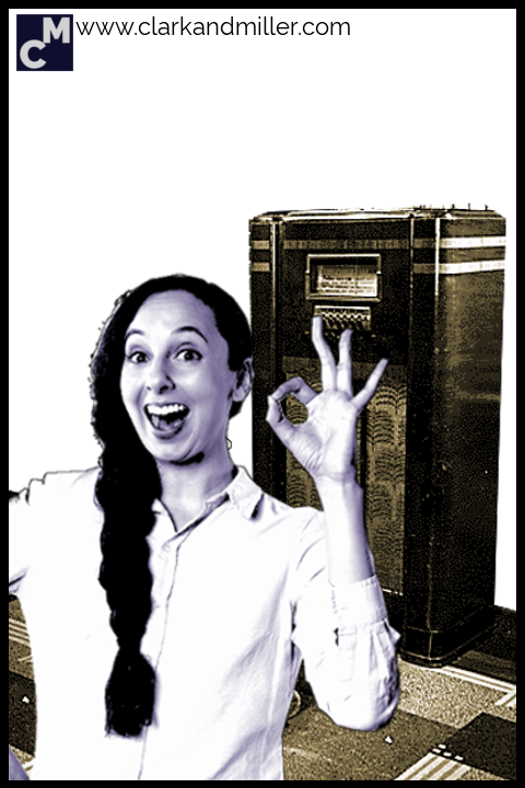 Smiling woman with old-fashioned radio