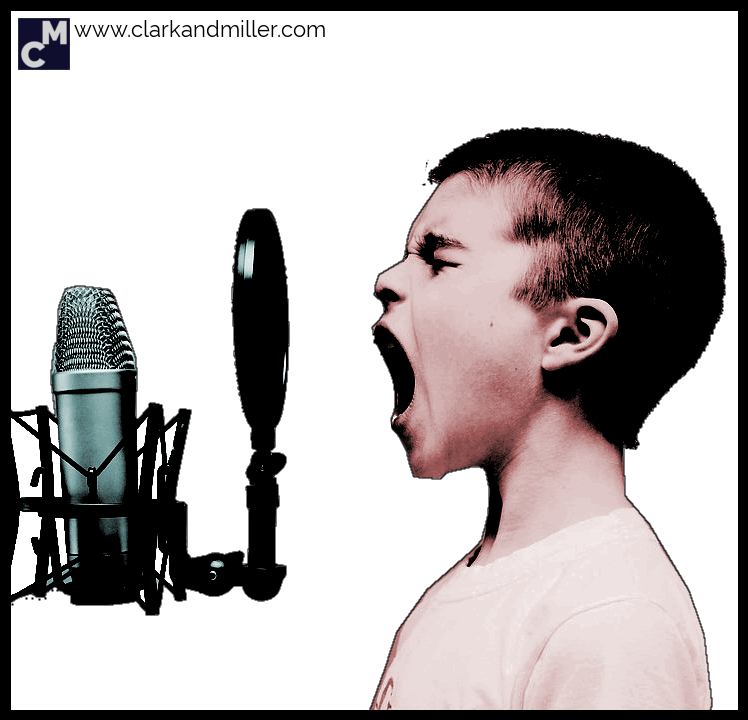 Singing boy with microphone