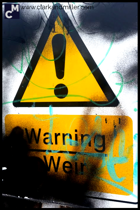 Street sign with graffiti