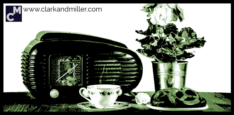 Old-fashioned radio, tea, biscuits and flowers