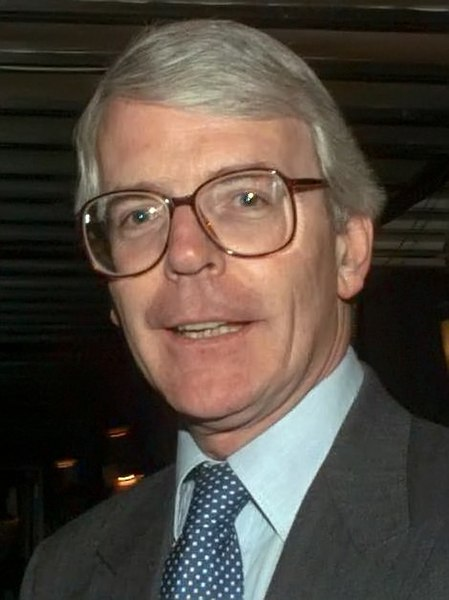 A photo of John Major's face; his lips are barely visible