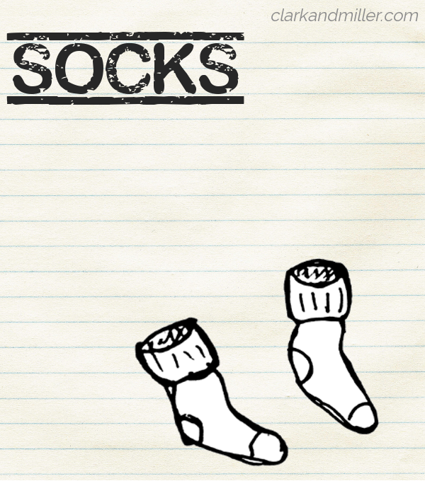 "Sketch of a pair of socks on lined paper with the word ""socks"" in capital letters"
