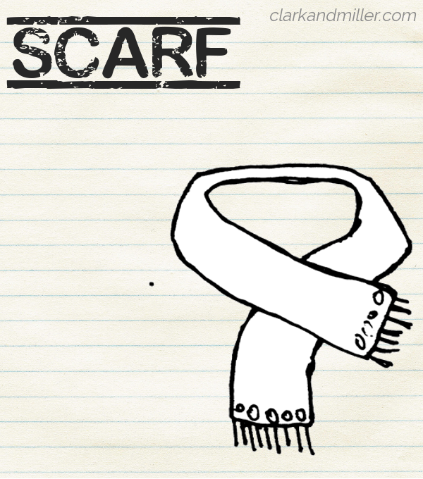 "Sketch of a scarf on lined paper with the word ""scarf"" in capital letters"