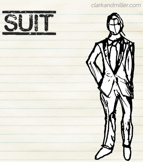 "Sketch of a suit on lined paper with the word ""suit"" in capital letters."
