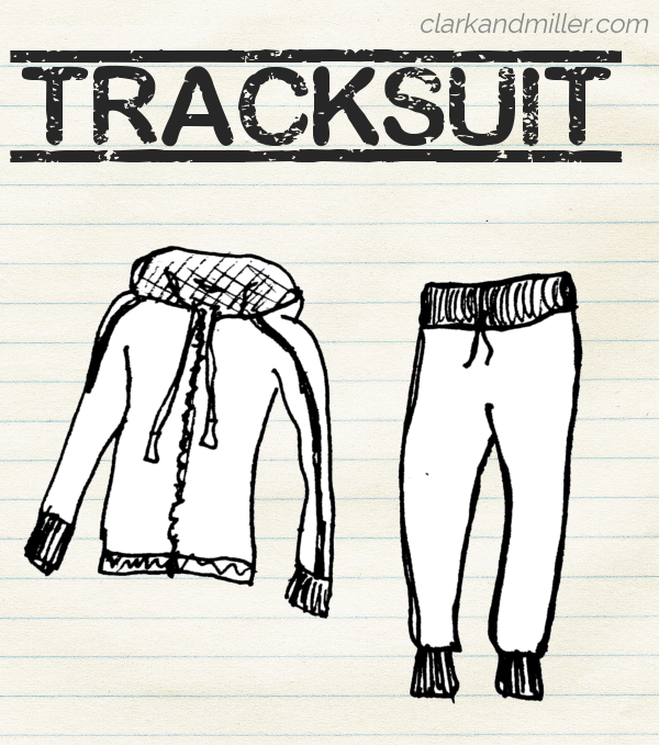 "Sketch of a tracksuit on lined paper with the word ""tracksuit"" in capital letters."