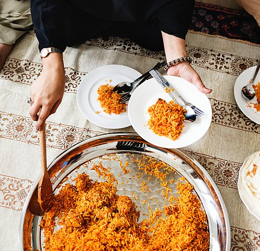 Woman serving rice